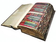 18th century book contains a record of cloth patterns available for purchase by customers from cloth producers in Norwich, England.  A showcase of cloth slips with handwritten numbers next to them for easy reference.
