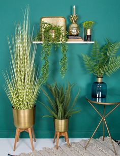 We've gone for the full wall styling here, to show how a few faux plants and a white marble shelf can make a vibrant and exciting vignette of green and gold in your home. So lots of gold for a really luxe look but softened with stacks of faux plants that are a dream for the non-green fingered amongst us. It couldn't be easier!