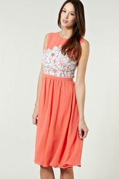 This cute pastel piece embraces multiple key-trends.The dress encompasses a  high neck fde6cea512
