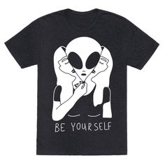 Show off your true alien self with this funny and weird, alien believer shirt. I want to believe! No go ahead and unzip your human face, you've had a long day of trying to fit in. Perfect for alien lovers, introverts, and those who just want to be their true selves.  Free Shipping on U.S. orders over $50.00.