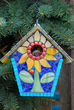 This stained glass mosaic bird house can be used outdoors or displayed indoors. Designed to be the perfect size for our wonderful small songbirds. Complete with a removable base for cleaning and ventilation on the sides under the roof. The entire house is sealed for outdoor use. Be sure to hang your mosaic bird house in a shaded area, at least 6 above the ground. Birdhouse measures 8 X 9 X 7. To safe guard against freezing temperatures and harsh winds, we recommend storing all garden art in…