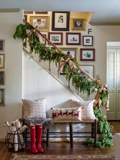 Christmas decorating, stair rail garland, gallery wall, bench.