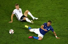 Stefano Sturaro of Italy is tackled by Toni Kroos of Germany  during the UEFA EURO 2016 quarter final match between Germany and Italy at Stade Matmut Atlantique on July 2, 2016 in Bordeaux, France.