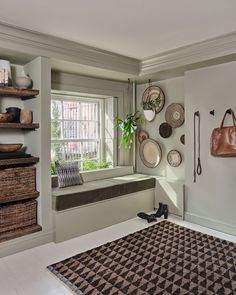 From 125 glass bottles to a gallery wall of cutting boards, nothing about this Brooklyn brownstone is expected. Tour the full space here. New York Brownstone, Brooklyn Brownstone, Brownstone Homes, Townhouse, Nook, White Floorboards, Relax, Formal Living Rooms, Home Interior