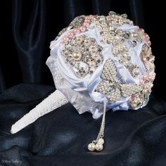 Bouquet made from white satin,lace and brooches. Brooch Bouquets, Brooches, White Satin, Wedding Bouquets, Fashion Backpack, Bride, Luxury, Lace, Wedding Bride