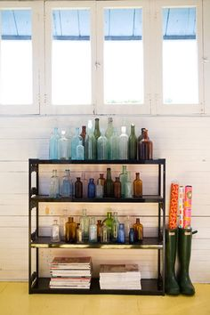 Design Sponge Sneak Peek; Rachel Thurston. As I recall this was part of someone's collection of bottles they used at there wedding reception. This made me feel a little less lame for my old bottle love.