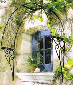 my most fav iron piece to have over individual windows so i can have climbing roses, bouganviella, clematis grow close to my windows! Not too much tho, i want the iron arch to be seen too!