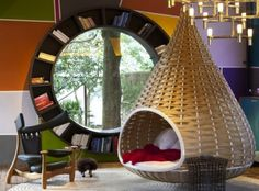 Lively urban cabin in Brazil features nest beds and a spherical shelf window