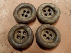 4  large stoneware pottery clay buttons… with a leather brown semi matte glaze..