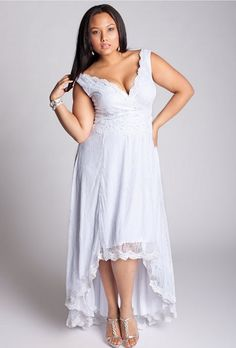 """Brides.com: Designer Plus-Size Wedding Dresses We Love. """"Evening After"""" floral French lace gown with sequin, bead and pearl scalloped edge lace belt that ties with oversized charmeuse, $525, IGIGI  See more asymmetrical wedding dresses."""