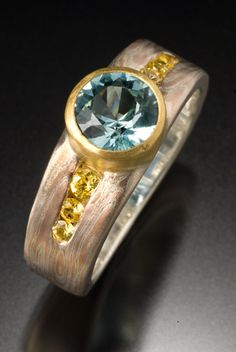 CTT. Sterling silver, recycled 14 karat rose gold, 18 karat gold, yellow sapphires and aquamarine. Channel set and Bezel set.