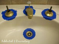 Painted Bathroom Faucets & Shower Enclosure - Addicted 2 Decorating®  1) sand 2) #000 steel wool 3) rustoleum auto primer 4) rustoleum universal