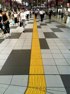 Tactile Paving for the visually impaired. This acts as a network of guiding pavement, different textures have different meanings. Japan