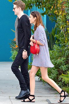 Alexa Chung, Pixie Geldof and George Barnett out and about in LA on 28 January 2014. Red circle bag black sandals plaid dress