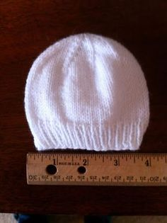 My sister makes me the best hats for my angels. Darling, soft, perfectly knitted, and STRETCHY. Stretchy is the key, folks. It's super i...