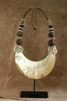 New Guinea | Necklace from the Korowai people. Mother of pearl, shell, wood and natural fiber | 300$ (includes stand)