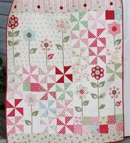 I made two quilts like this. They are for twin girls in our neighborhood. Their dad has a lot of business dealings with my husband. I tried to upload the pictures, but I keep getting a symbol, and the picture does not show up.