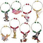 Mickey, Cheschire Cat, White Rabbit, Tinkerbell, Dumbo, Dopey,   Pinnocchio, Jiminy Cricket Wine Glass Charms. Made to go with World of Disney Christmas Dishes, but not too Christmas-y to be used all year round!!
