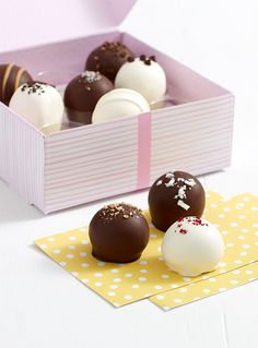 "Mom is inspiring, generous and loving. What better way to show your love than with a gift that says all that... and so much more. This thoughtful surprise begins with rich, bite-sized cake truffles in an assortment of gourmet flavors. Tucked into an artfully decorated box, each cake truffle has a message for Mom hidden beneath it, like ""You give the best hugs"" and ""You inspire me""."