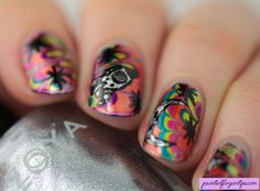 Painted Fingertips | Brightly coloured water marble with spacey nail art