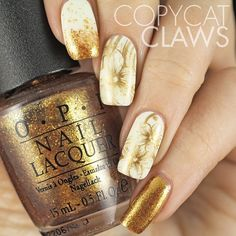 A beautiful white and gold nail art design with flower patterns. The nails are painted with amazing flower designs in gold glitter along with full gold glitter designs as well.