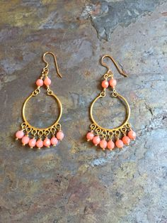 A personal favorite from my Etsy shop https://www.etsy.com/listing/399988841/coral-gemstone-gold-chandelier-statement