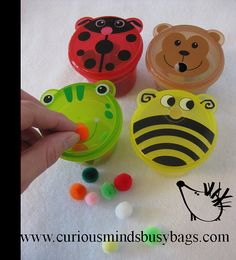 Feed Me Busy bag pom pom stuff by CuriousMindsBusyBags on Etsy $5.50 (just fyi these little tubs are available at the $ Tree)