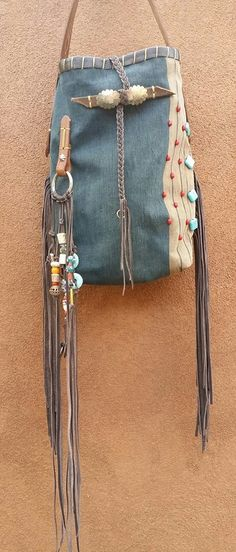 Nao Bag it is made from a vintage Indigo dress from Laos. The wonderful aging of the indigo gives the color that best worn jeans from back in the day. I was able to use one of the amazing hand tooled belts that I have recently aquired. Miles of fringe .... LOVE IT