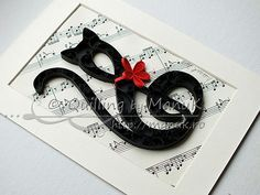 I made this quilled G clef/cat as a gift for a very good friend who recently graduated from a course. I am really happy for her and decided to give her a l