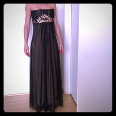 Emma Savahl Couture hand painted gown This Emma Savahl evening gown features hand painted designs and Swarovski crystals. The outer sheer layer is black with a nude lining underneath. This dress has only been worn twice to formal events, and is in perfect condition. Emma Savahl Dresses Strapless