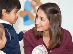 Teacher's Aide working with Autistic Children
