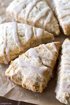 These light and flaky scones are full of sweet maple flavor and topped with a cinnamon spice glaze!:
