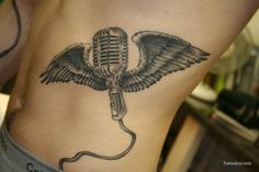 Microphone with Wings Tattoo