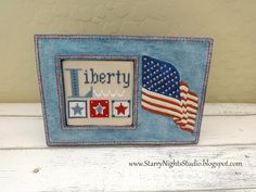 Inside Starry Nights Studio, Liberty sampler by Lizzie Kate finished in a blue jean American Flag frame #lizziekate #crossstitch