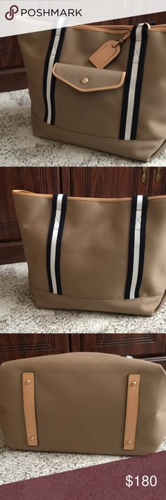 """Dooney and Bourke tote Tan cabriolet tote with navy and white, web and vachetta leather  handles.  Inside lined with zipper and slip pocket  on back wall, 2 slip,pockets on opposite wall, snap pocket on front of bag, measures 18"""" wide, 13"""" high, 8-1/2"""" deep, handle drop 9-1/2"""" no marks inside or out from a smoke free home Dooney & Bourke Bags Totes"""