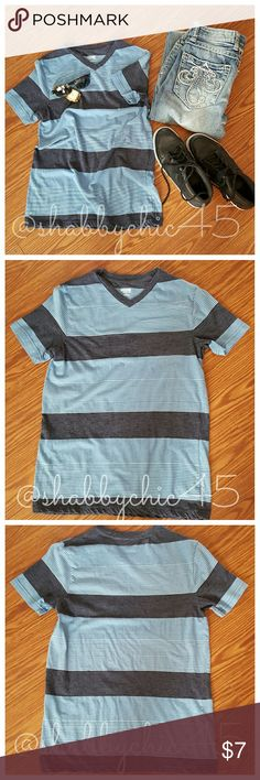 ??Trendy Striped V-neck T-shirt by Mossimo ??Back to School Special?? EUC Mossimo striped tee in faded denim and navy with white stripes.  Very soft fabric making it extremely comfortable! Great for back to school! PRICE IS FIRM.    ??Smoke free home. No trades. Open to reasonable offers unless marked as firm.? Happy Poshing!! ?? Mossimo Supply Co Shirts Tees - Short Sleeve