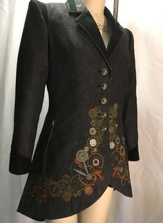 This is my Steampunk inspired denim jacket. Embroidery designs are OESD and the quilt line designs are converted to triple stitch using BERNINA D+V8. Many motifs are combined in the software and 5 hoopings on each side are placed and mirrored with BERNINA 880 Virtual Positioning. Buttons are created from BERNINA rotary bobbins.