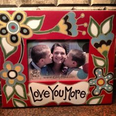 """Love You More Glory Haus Picture Frame 10 X 12"""" by Glory Haus. $31.25. Sold Individually. Measures 10 X 12"""". Holds 5 X 7"""" Picture. Beautiful picture frame from Glory Haus reads """"Love You More"""". The frame measures 10 X 12"""" and can be hung on the wall or stand on a counter or shelf. Makes a great decorative addition to any home!"""