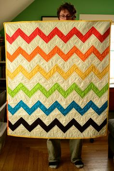"""Rainbow Chevron Quilt"" by Maritza Soto of Knotty Bits.  We are still riding the #zigzag #chevron trend and this is gorgeous!"