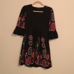 Reborn Boho Dress Black with the most beautiful colors and arty flowers on the sleeves and the bottom of the dress. The sleeves are 3/4 and puffy style. Excellent condition Reborn Dresses Midi