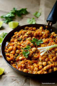 The addition of greens to this chickpeas curry elevates it from a lay man's food to a dish from a gourmet kitchen!