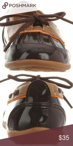 Jumping Jacks Raindrop waterproof shoes Brown NIB Jumping Jacks (Balleto) the Raindrop style boat shoes. Brown with Tan and orange accents. She is sure to seek out puddles and wish for rainy days with this fun skimmer. This foul weather friend boasts a puddle friendly waterproof rubber upper with a contrast collar and simple tie closure with a slip-on styling that even Jumping Jacks Shoes Rain & Snow Boots