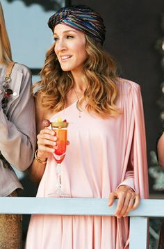 For the SATC sequel, Parker's Carrie Bradshaw rocked a pink jersey Halston Heritage Pretty Poncho Dress