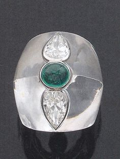 interesting belperron ring carved from rock crystal and inlaid with diamond and emerald