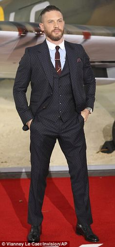 Dapper: Tom, who plays RAF pilot Farrier in the new film, looked appropriately dapper in a smart three-piece suit
