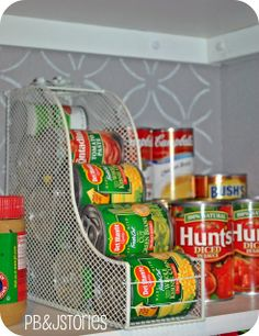 This is the greatest idea! Use a magazine rack, tip it on its side and put your pantry cans in it - Click image to find more DIY & Crafts Pinterest pins