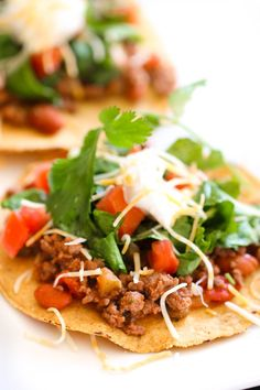 The easiest Ground Beef Tostadas are made with ground beef, beans, salsa, and seasonings. Dinner is ready in less than 15 minutes!