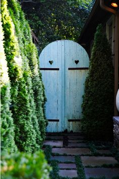 Inspire a rustic setting with curved double-wooden doors, painted a soothing color like light blue.