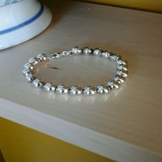 Tiffany & Co. Beaded Bracelet 7 inch bracelet. There's some tarnish between beads due to lack of use, but otherwise in excellent condition. I'm very open to offers! Tiffany & Co. Jewelry Bracelets