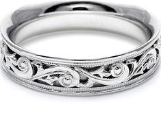 Tacori Mens Wedding Band With Hand Engraved Scroll Work -6.0mm  : This Men's wedding band showcases Tacori's signature three-dimensional Hand Engraved eternity scrollwork. The width of the band is approximately 6.0 mm.